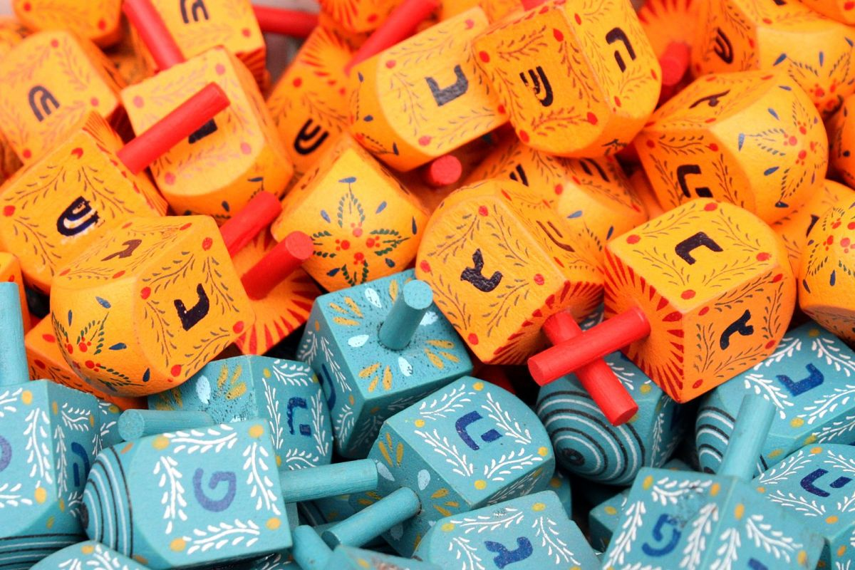 Dreidels for sale in Jerusalem, Israel with נ ג ה פ  on the blue dreidels and נ ג ה ש on the  orange dreidels.