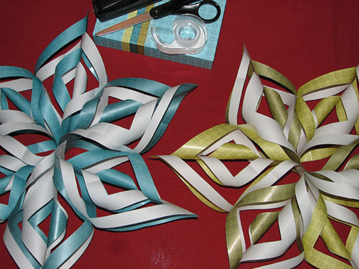 Old gift wrap can be turned into beautiful snowflakes!