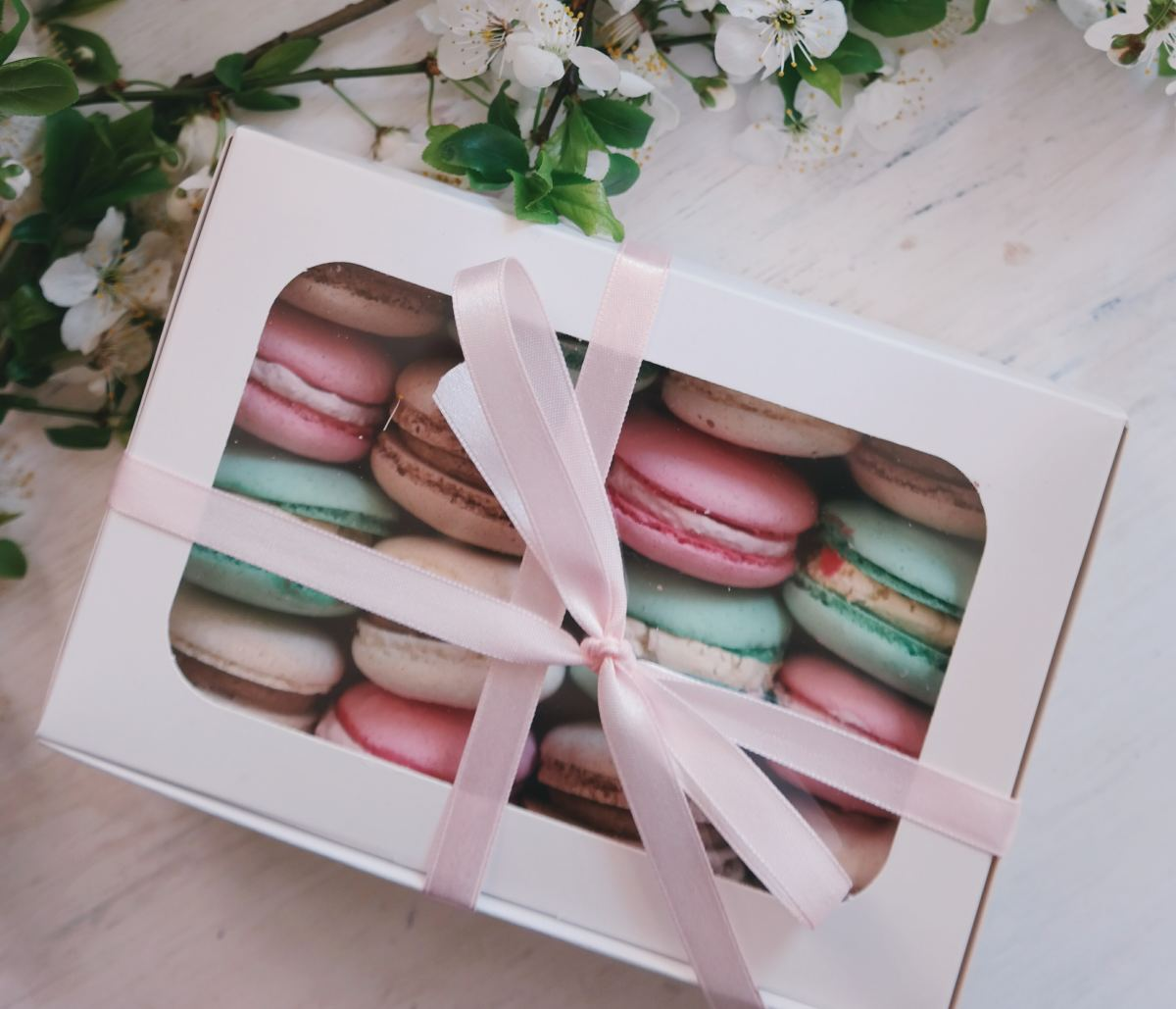 Macarons, chocolates, or other nicely packaged food items make for a nice Christmas gift that won't go to waste.