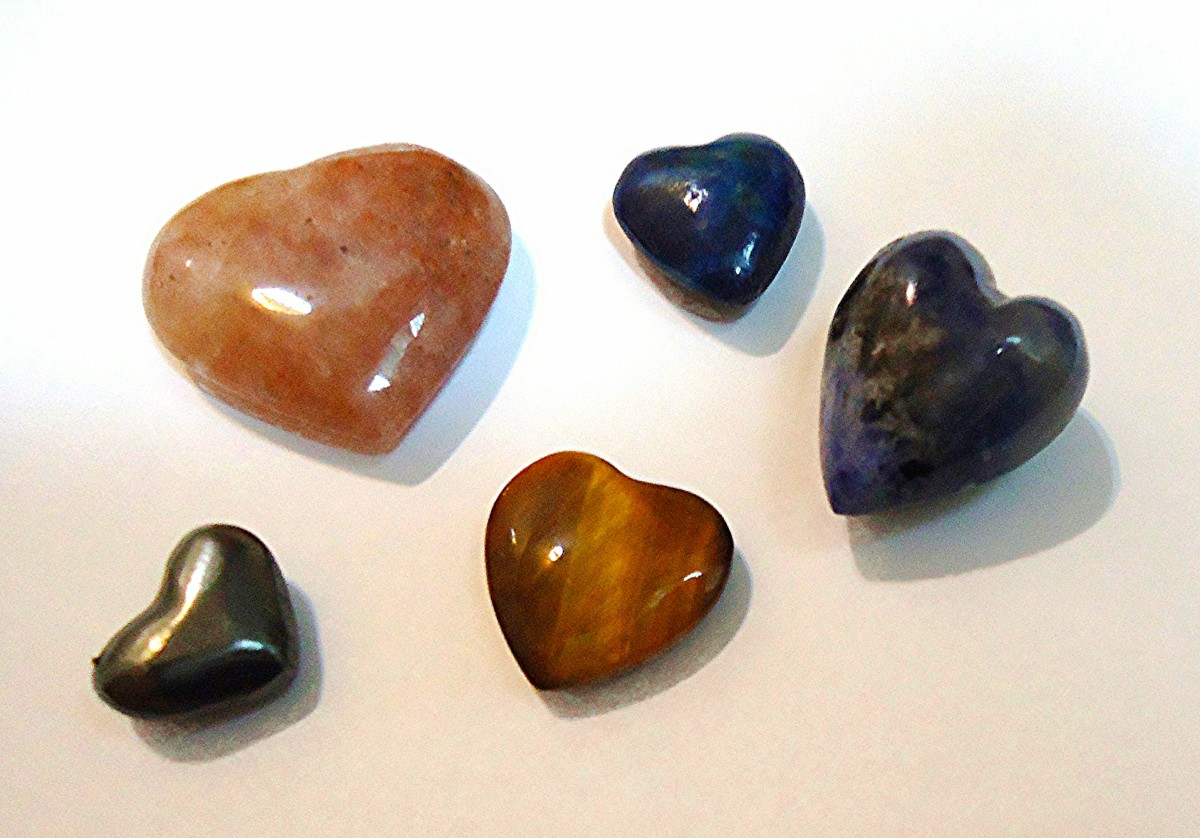 """Rose quartz (upper left) is said to be """"a happy and loving stone,"""" enhancing all types of love and reducing stress."""