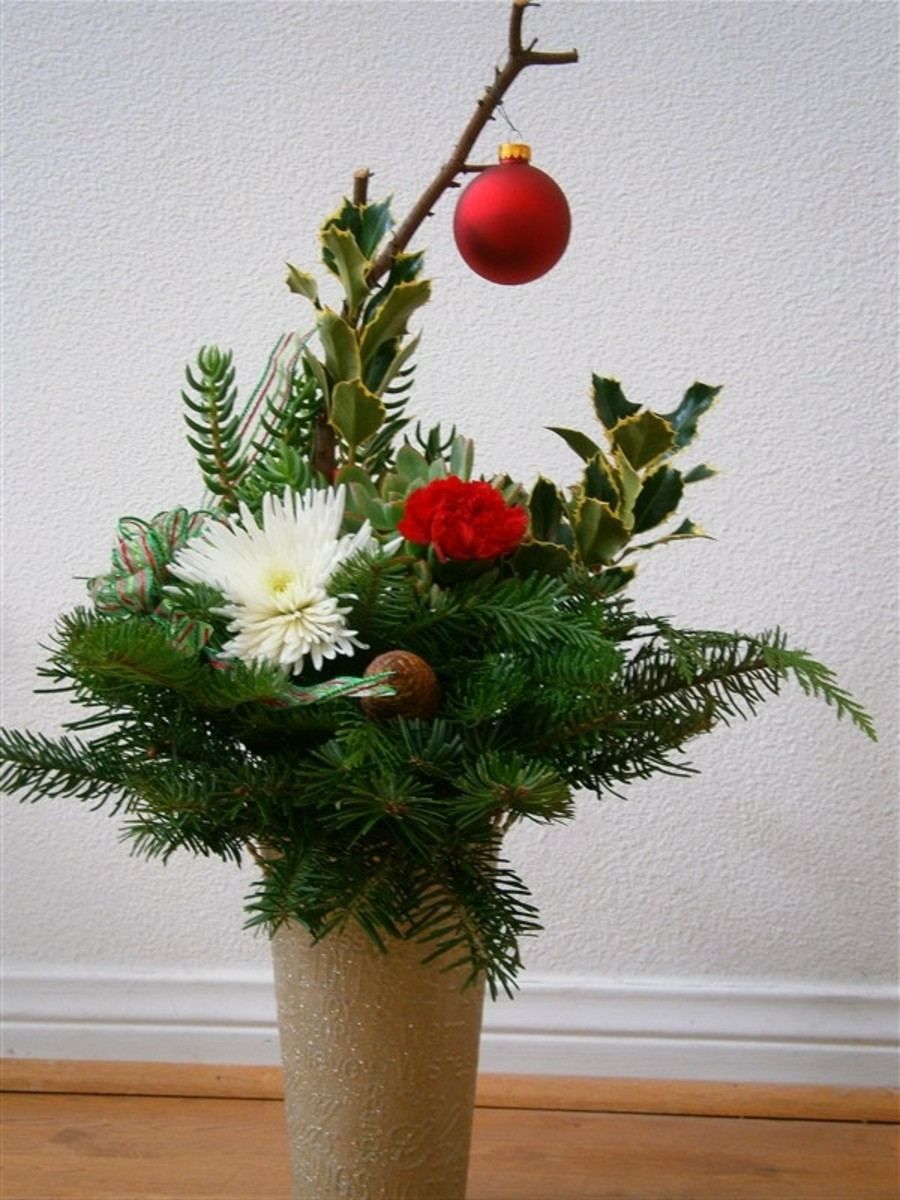 This centerpiece uses recycled ribbon, ornament and free pine cones and Christmas greens. The cost is taken up by the vase and floral foam.
