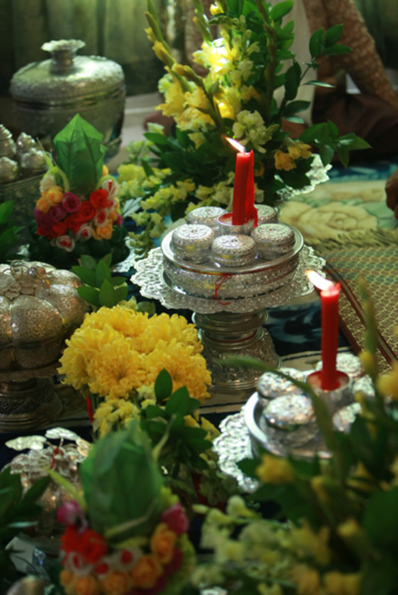 Silver and gold trays are traditional along with fresh fruit, flowers, and candles.