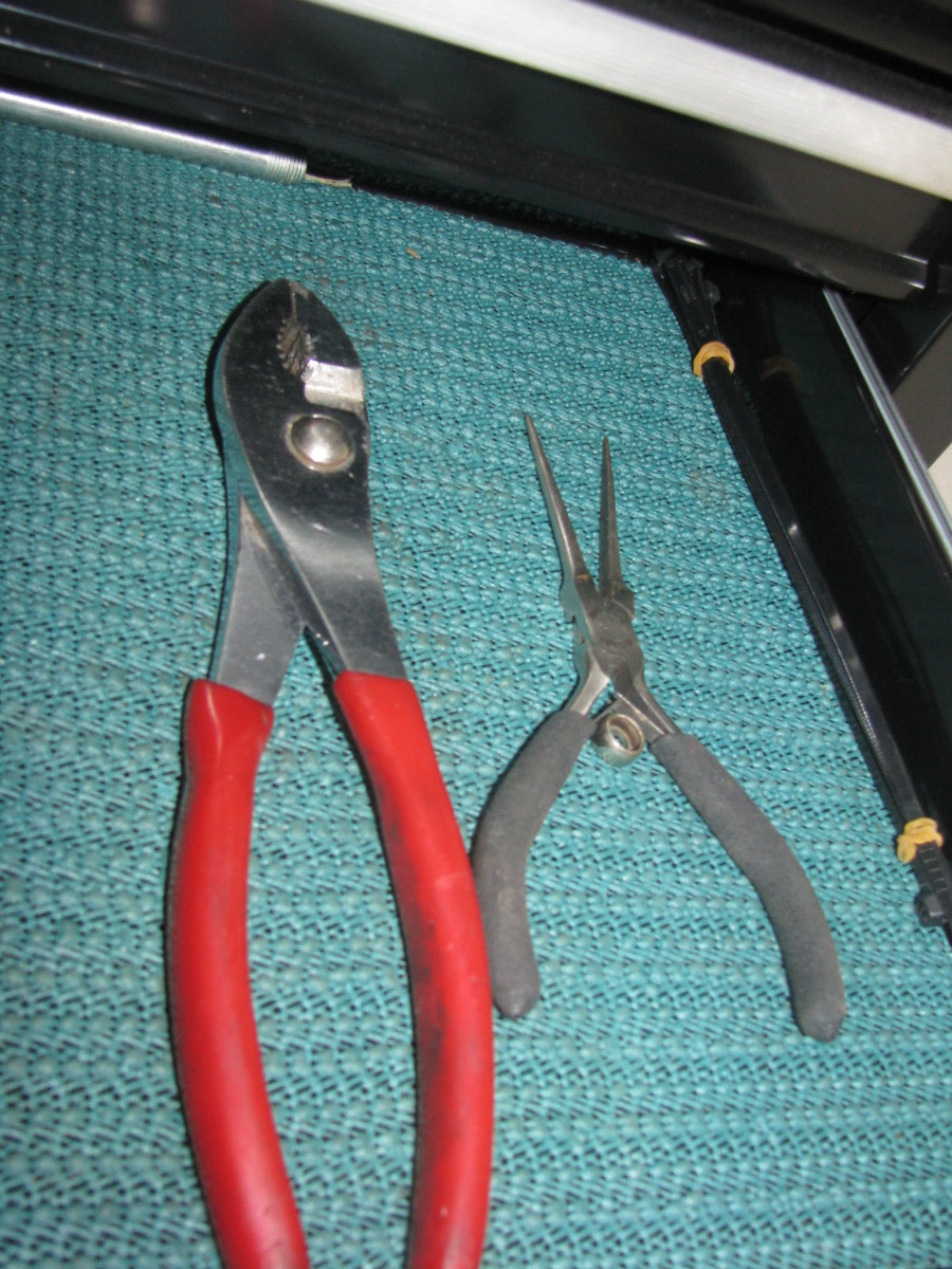 Combination pliers on the left Needle nose pliers on the right