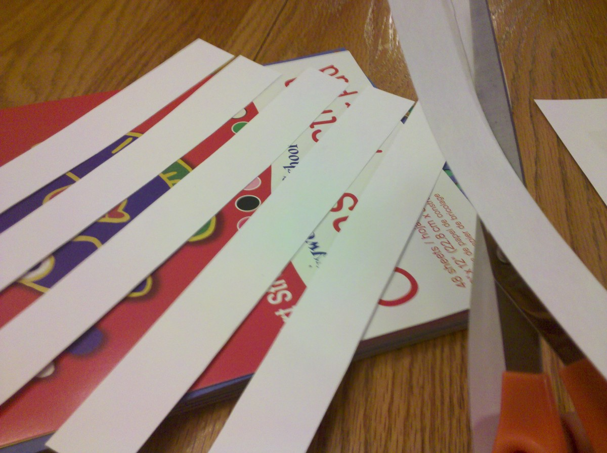 Cut strips of white cardstock paper.