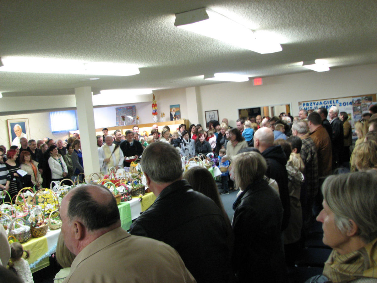 The blessing.  As full as the room was, more people came in part way through the blessing and added their baskets as well.