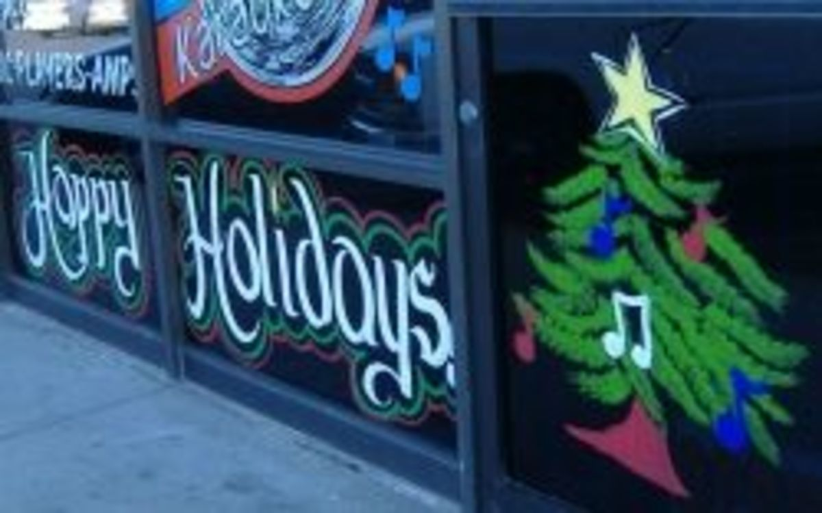 Happy Holidays lettering in a window painting.