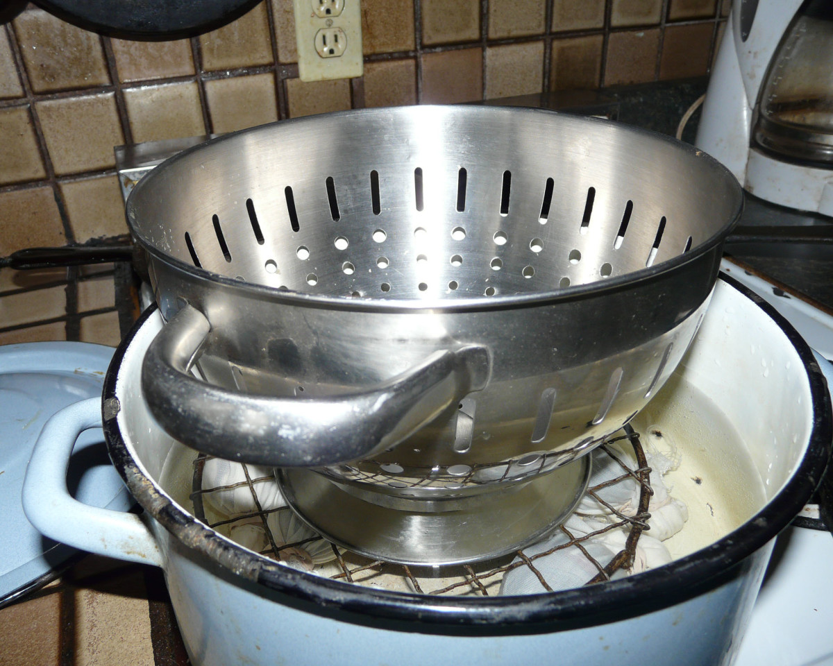 The colander provided extra weight to keep the eggs under water.