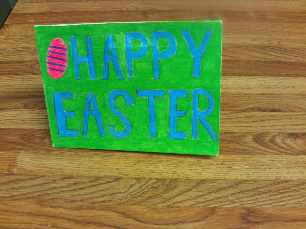 The front of the pop-up card was decorated with Happy Easter text.