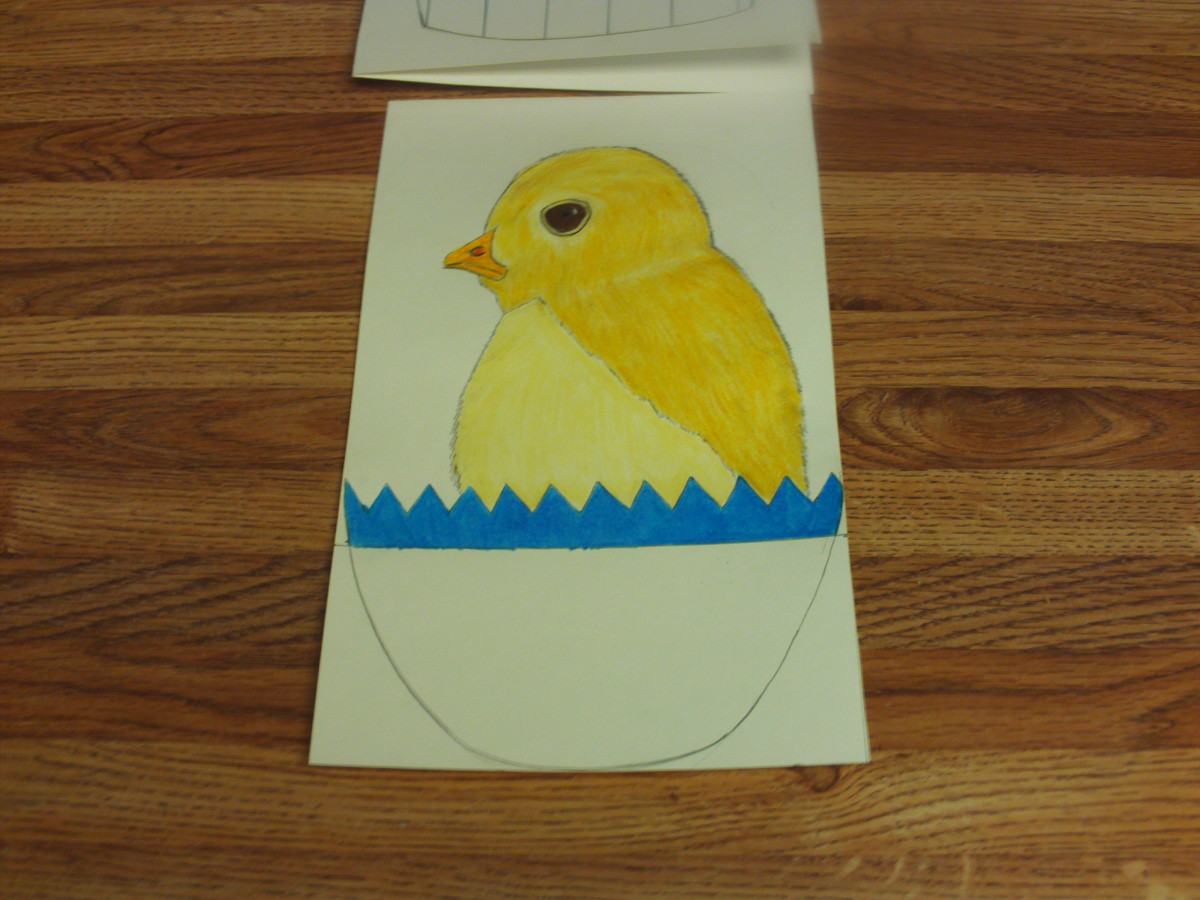Here I have added the deep brown eyes to the chicken, and shaded in the top of his blue egg.