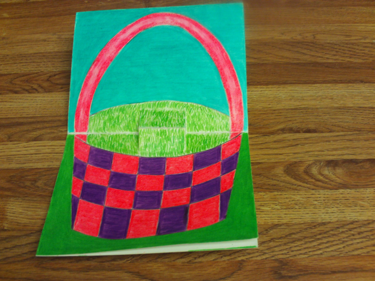 Here I have completed coloring in the basket with the pink and purple colored pencils.