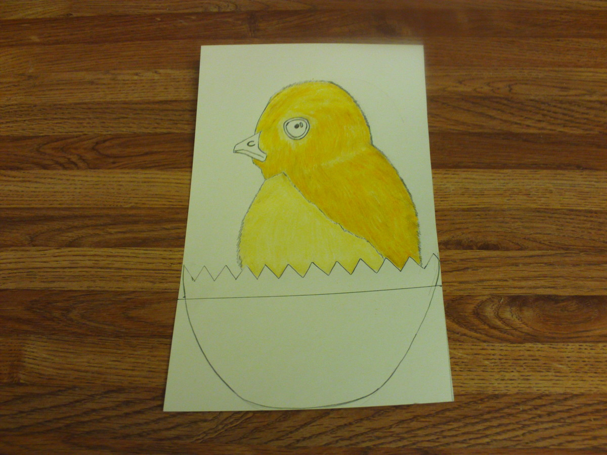 In this photograph you can see I have shaded in the darker gold portions of the baby chick's fur.
