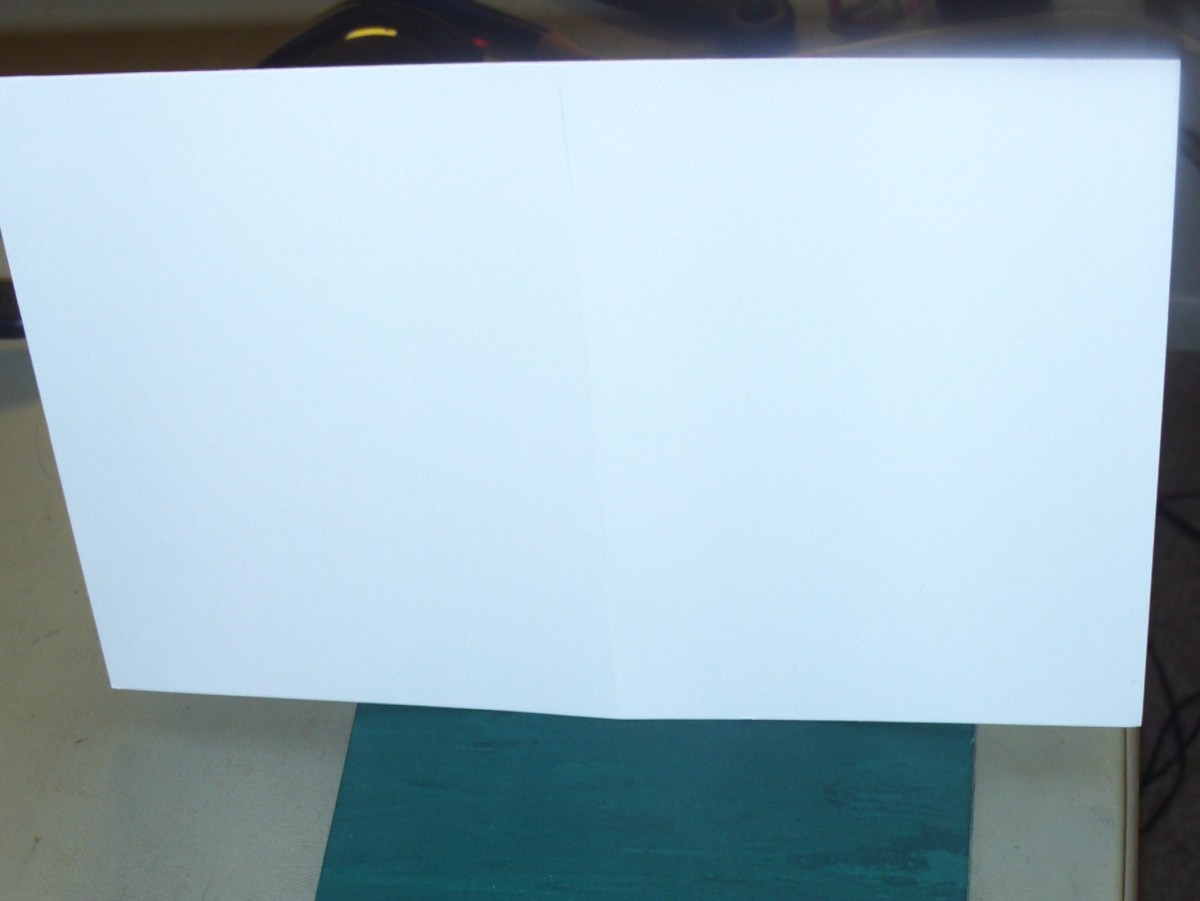 Fold the sheet of card stock in half to make a half-fold card.