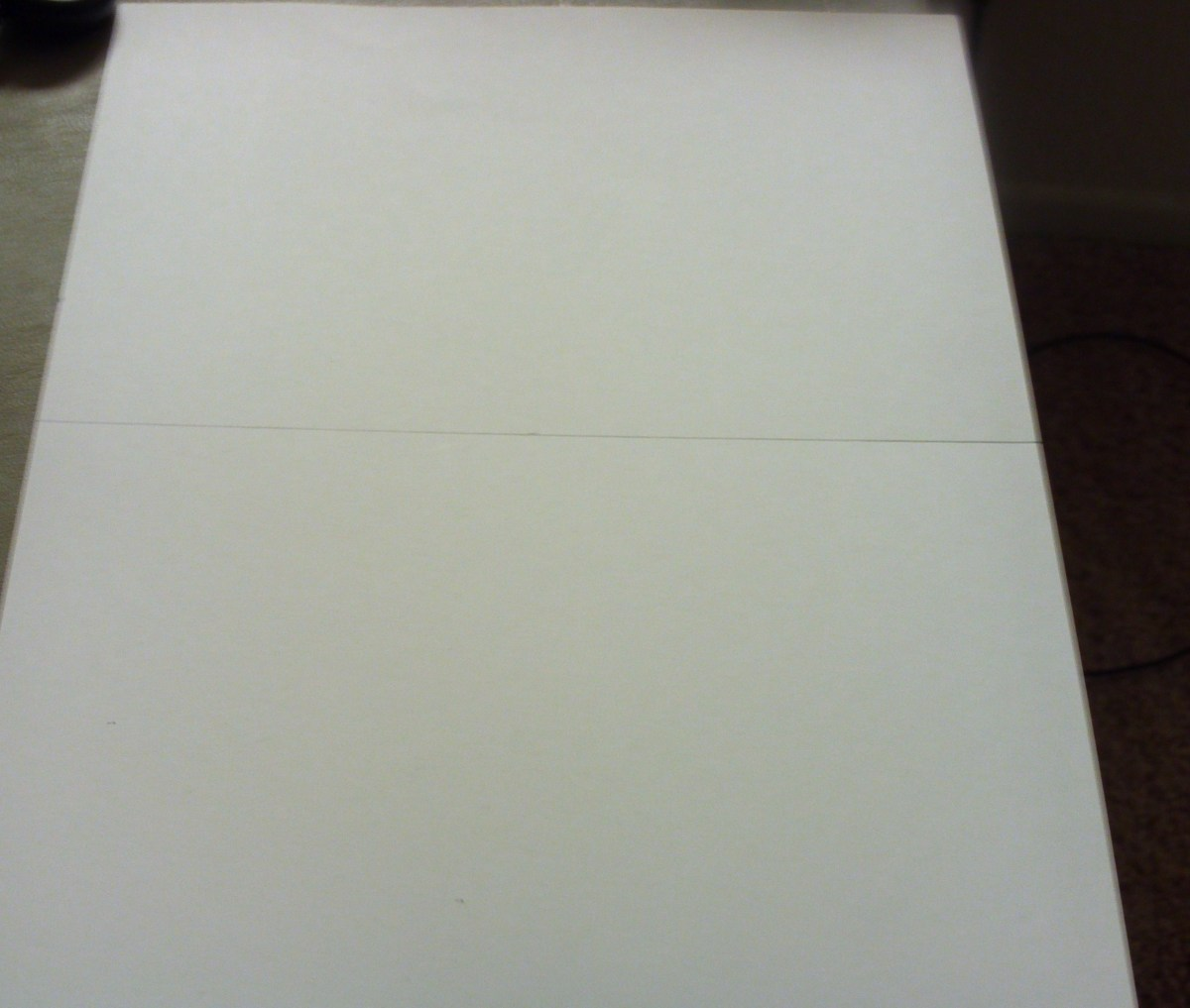 Use a ruler to draw a line down a 8 and 11 inch sheet of card stock.