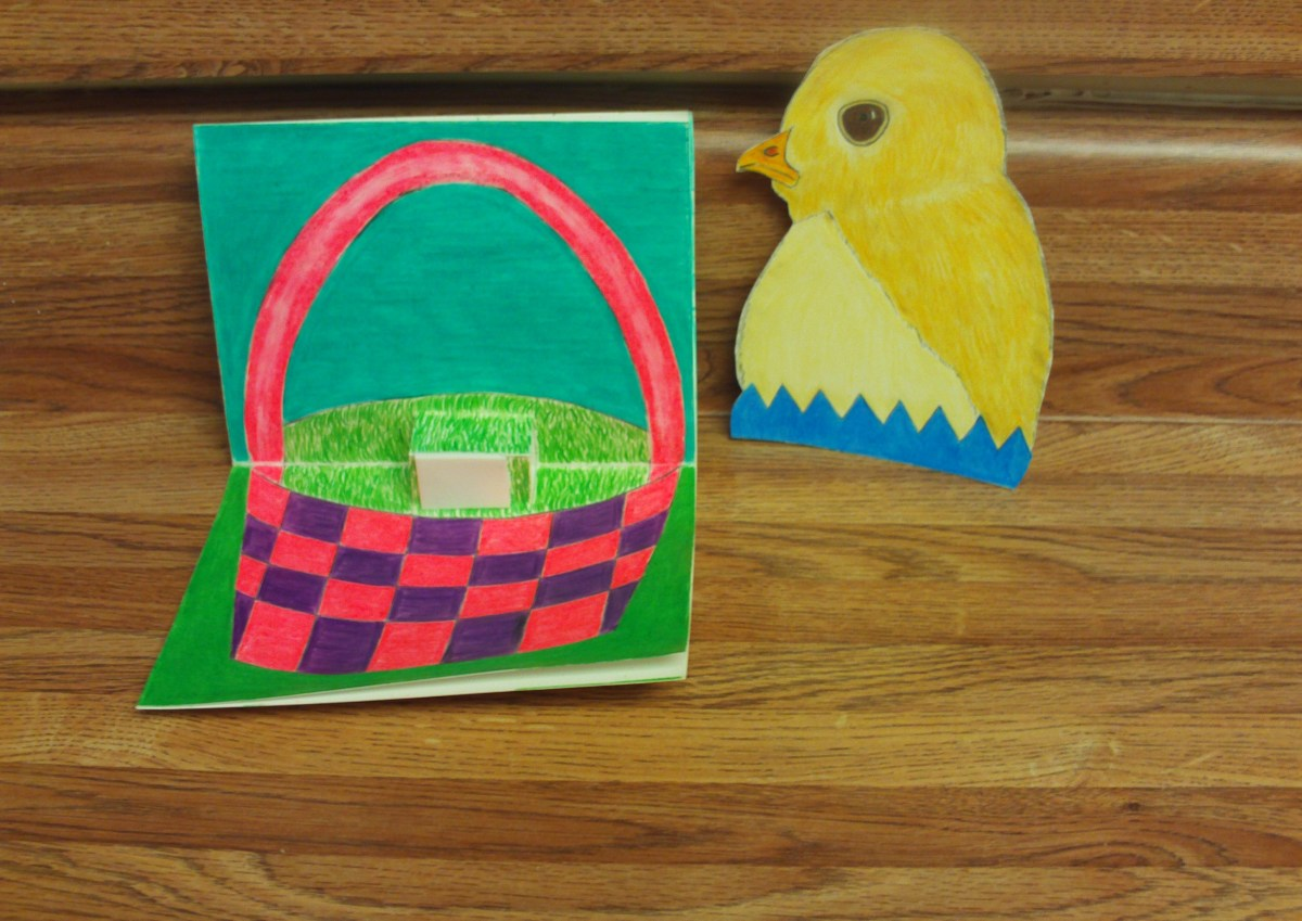 Here I have adhere a foam adhesive to the pop-up portion of the card.  I am now ready to attach the baby chick to the pop-up.