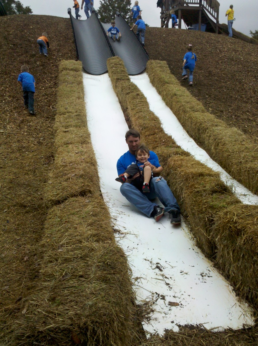Enjoying the super slide with Daddy.