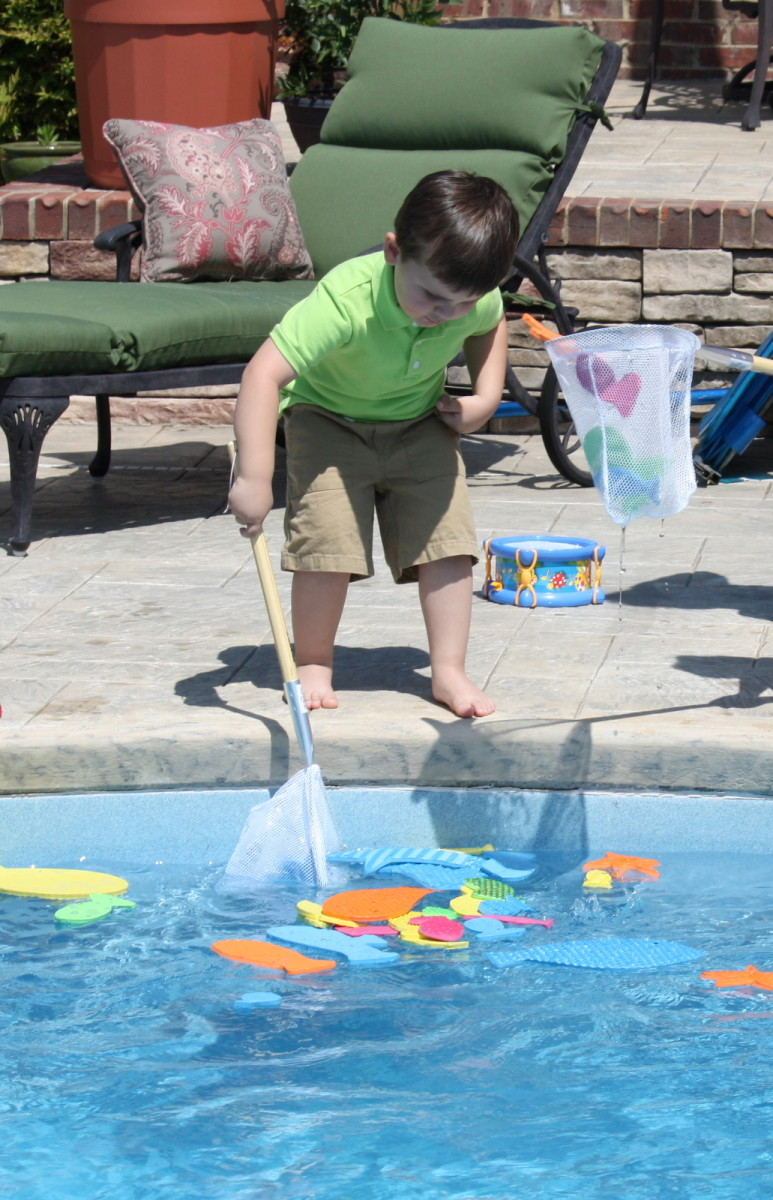 The birthday boy catching some fish!