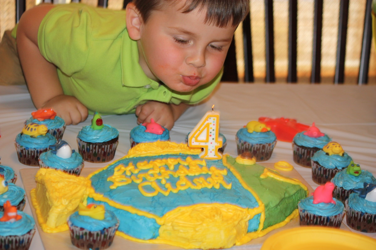 The birthday boy blowing out his candle!