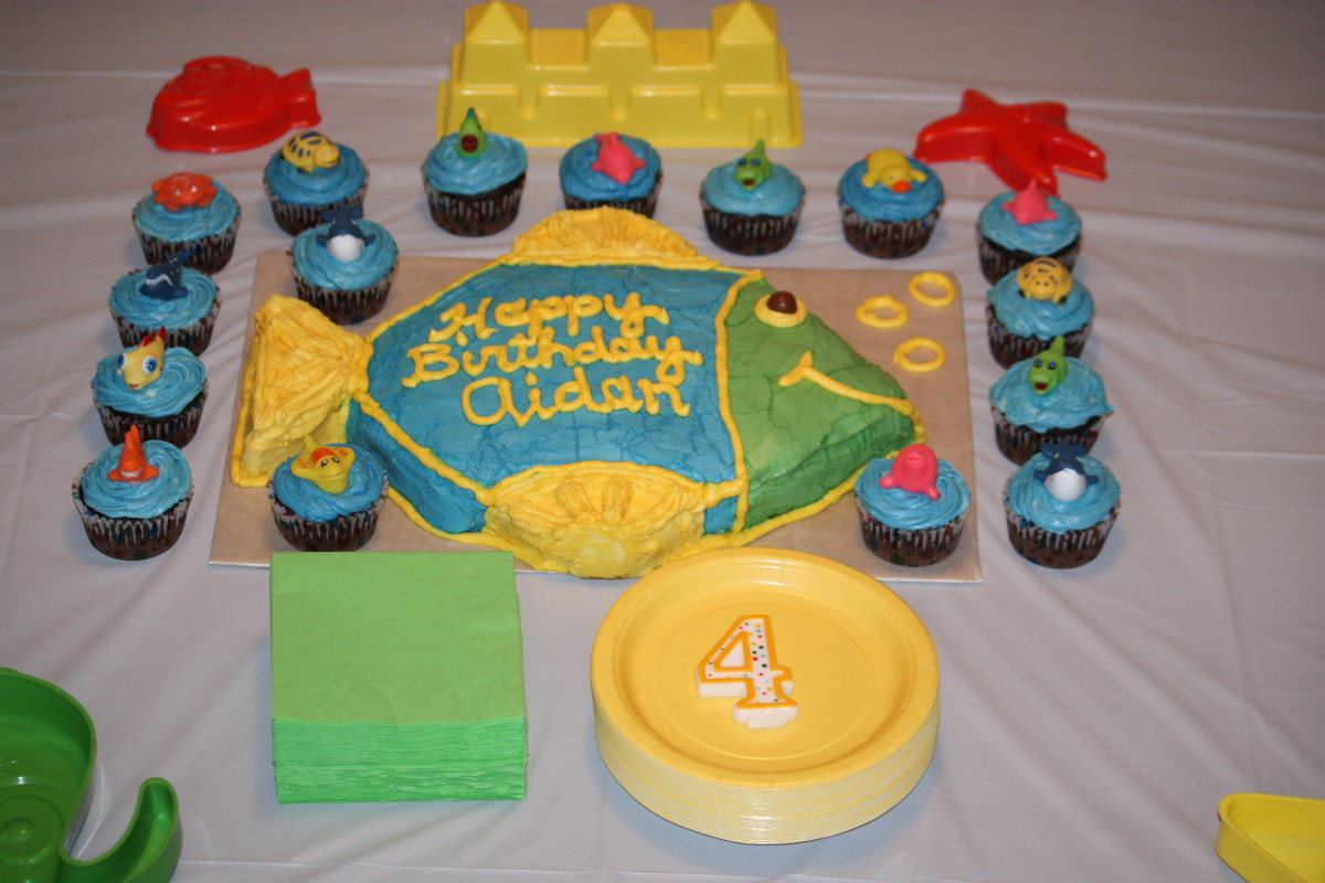 Fish shaped cake and under the sea cupcakes.