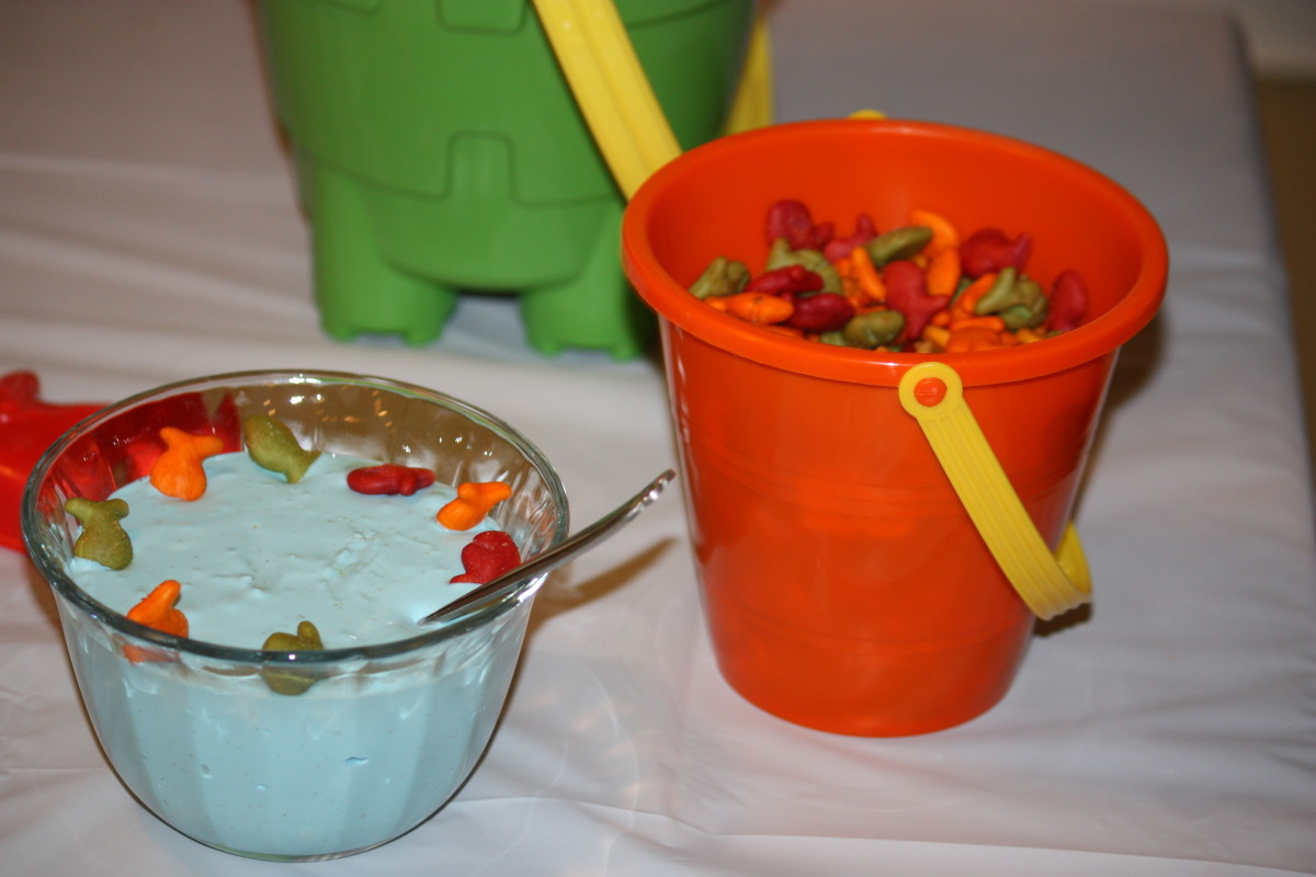 Goldfish and ocean dip made from blue food coloring and french onion dip.