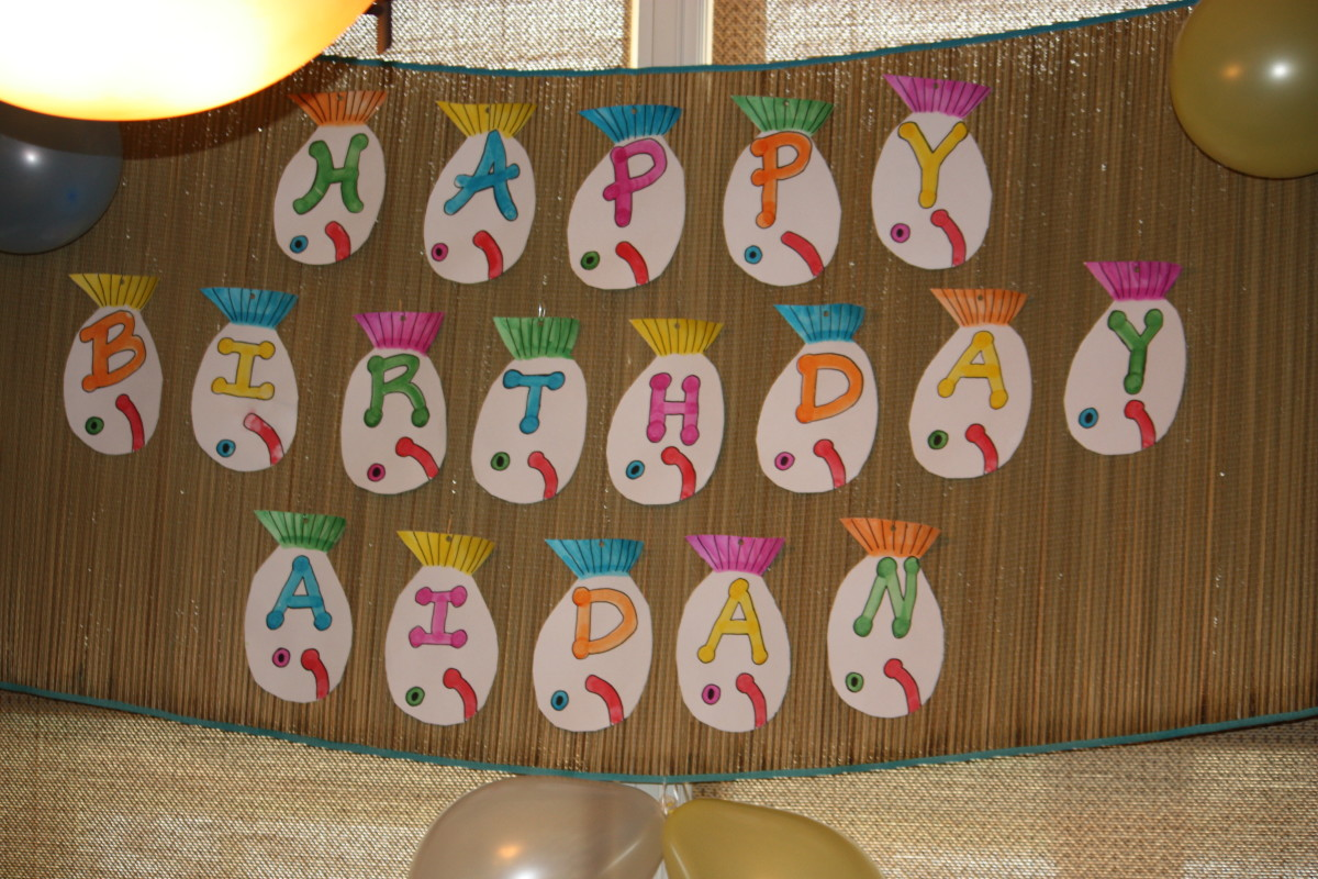 Ocean party banner made from cardstock paper, paper clips, and bamboo beach mat.