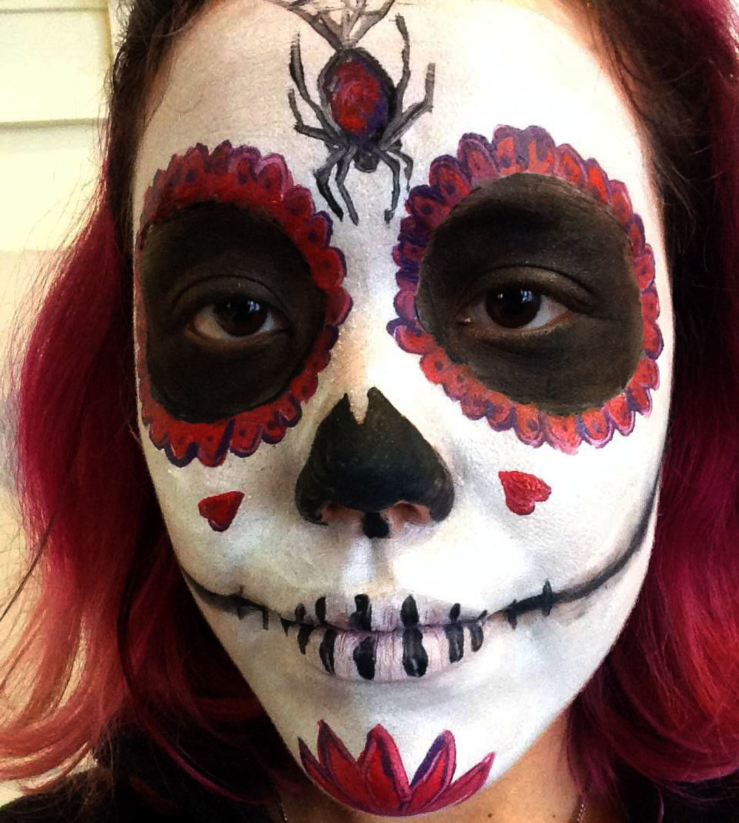Embellish your sugar skull with touches such as spiders, hearts, and flowers.
