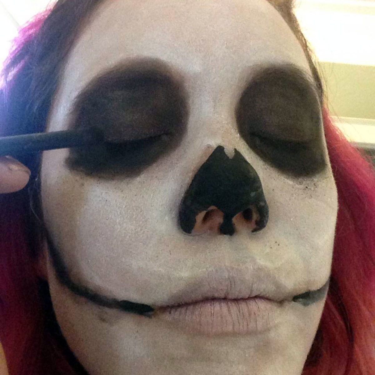 Use eyeshadow to shade in the eye sockets.
