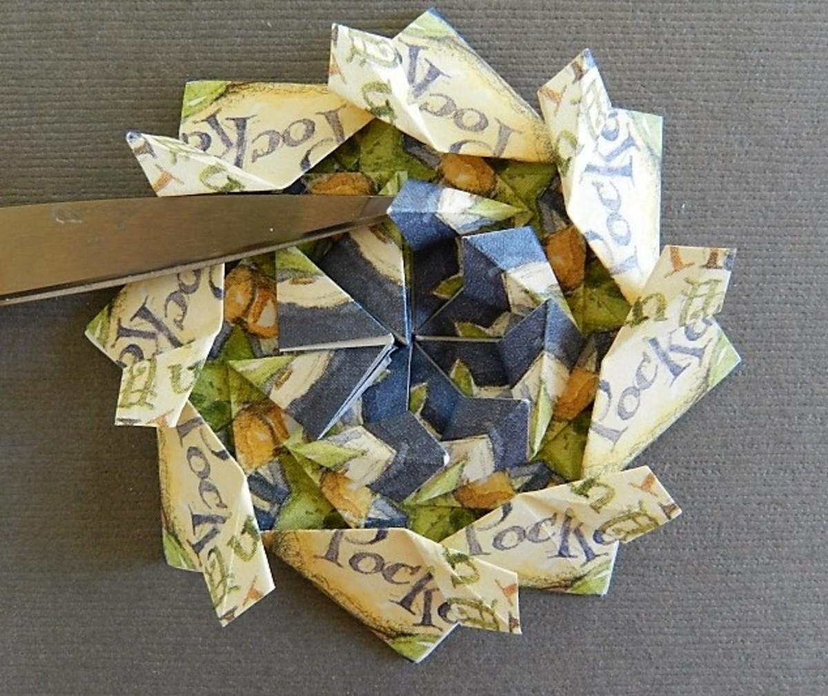 Open each fold into half kites.