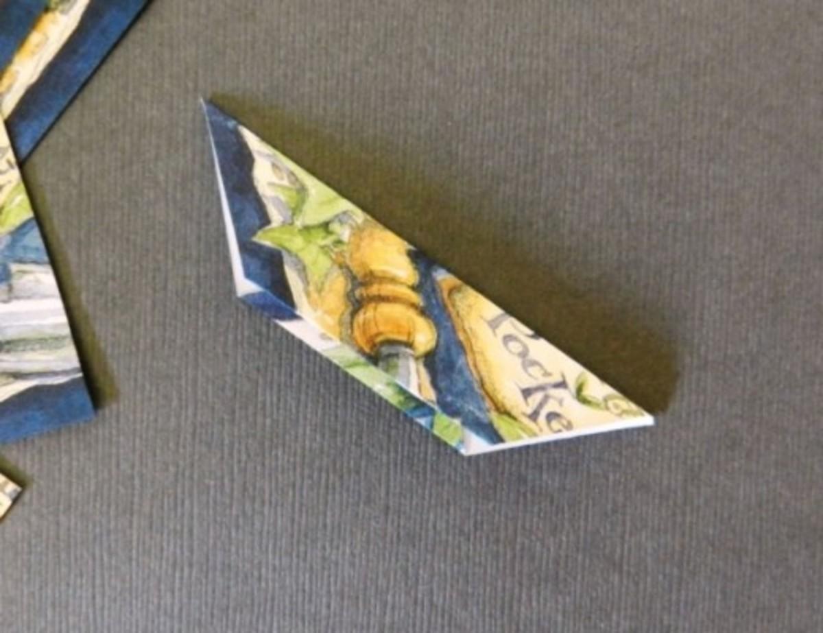 C) Fold in half diagonally