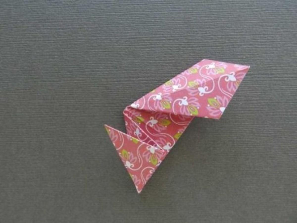Fold the bottom back a quarter.