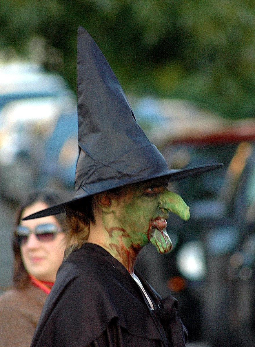 Witch with warty prosthetic nose and chin.