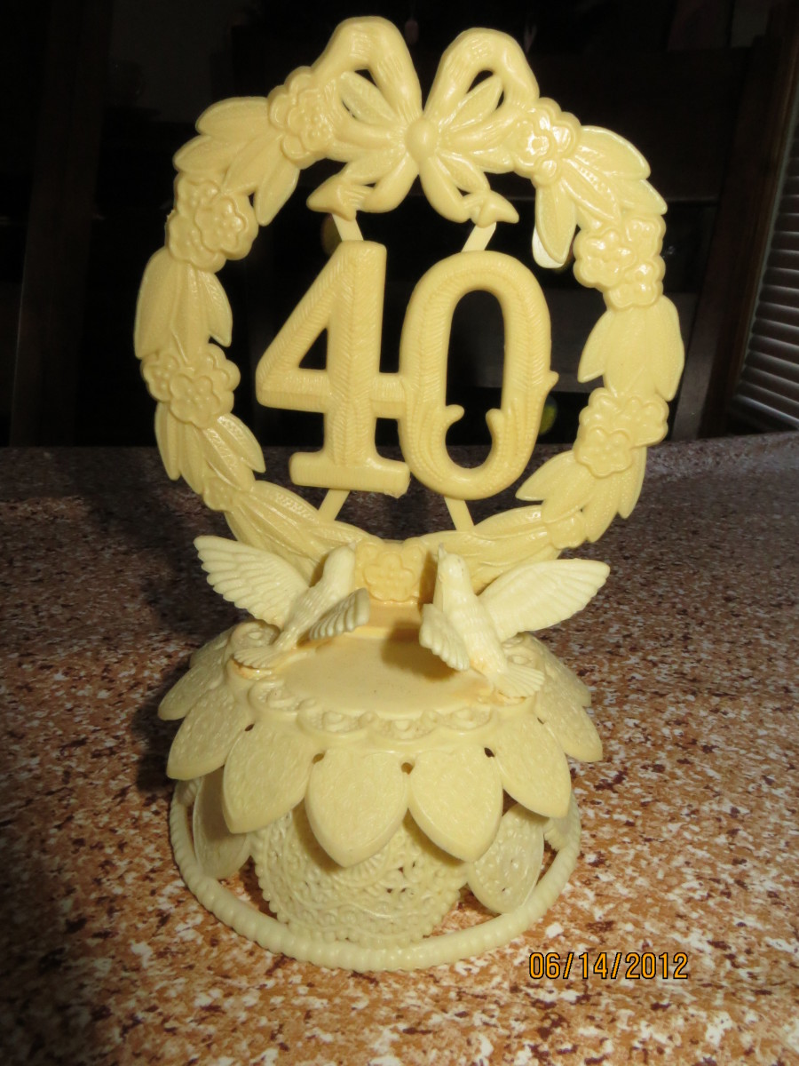 My in-laws 40th Anniversary cake topper given to us for our 40th!