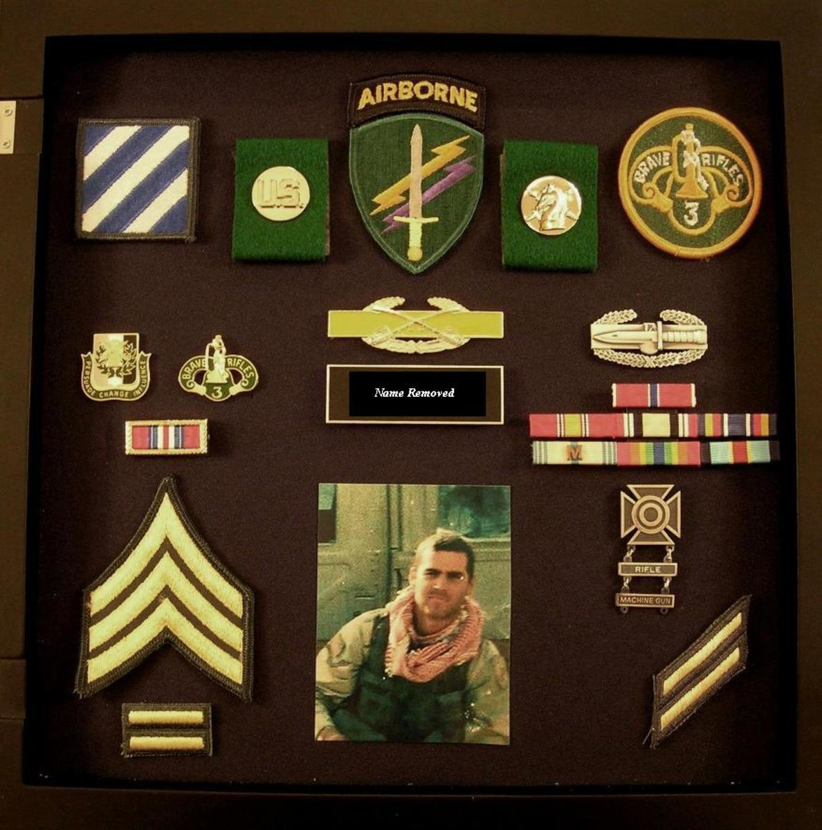 Use a shadow box to showcase memorabilia about your father or the two of you together.