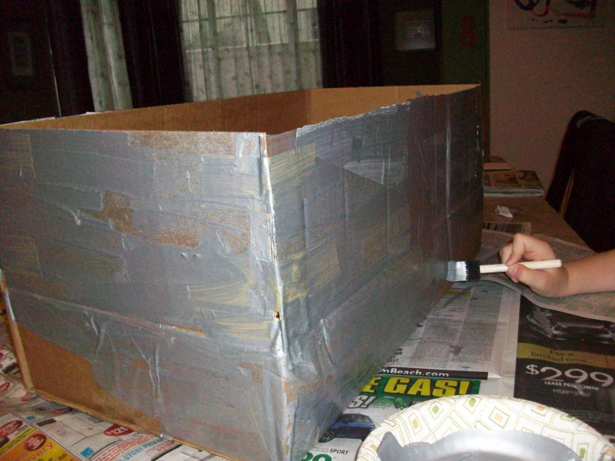 Paint the outside of the box with silver craft paint (or cover the whole thing in aluminum foil).