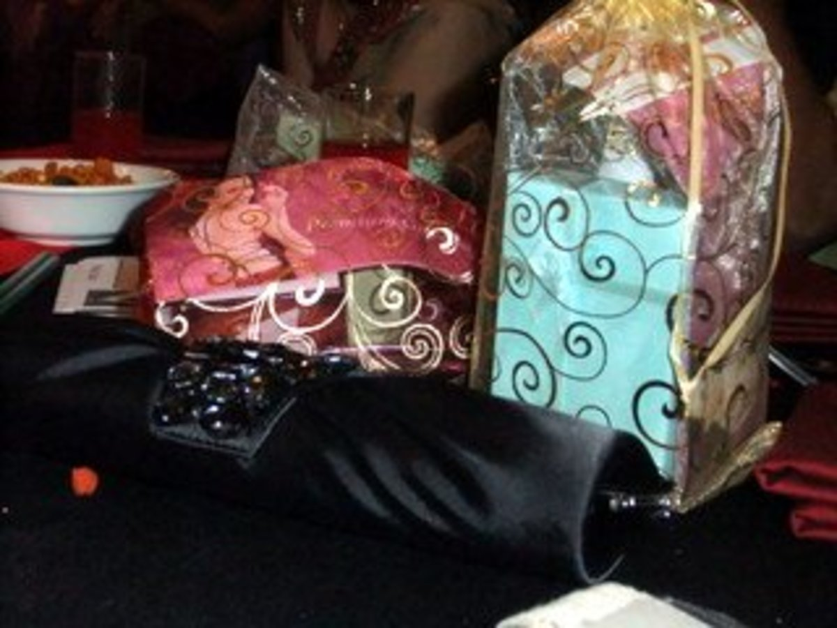 Photo 3: Door gifts or party favors wrapped in Indian saree fabric, in line with our Bollywood Dinner Party Theme