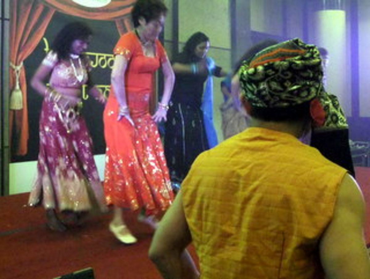 Photo 7: Bollywood Dance performance by one of the team competing for the Bollywood Dance competition