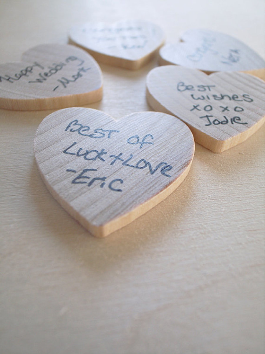 This is a sweet and inexpensive option to take any kind of wooden shapes, let guests write a little message and their name. Keep them in a glass container or other keepsake box.