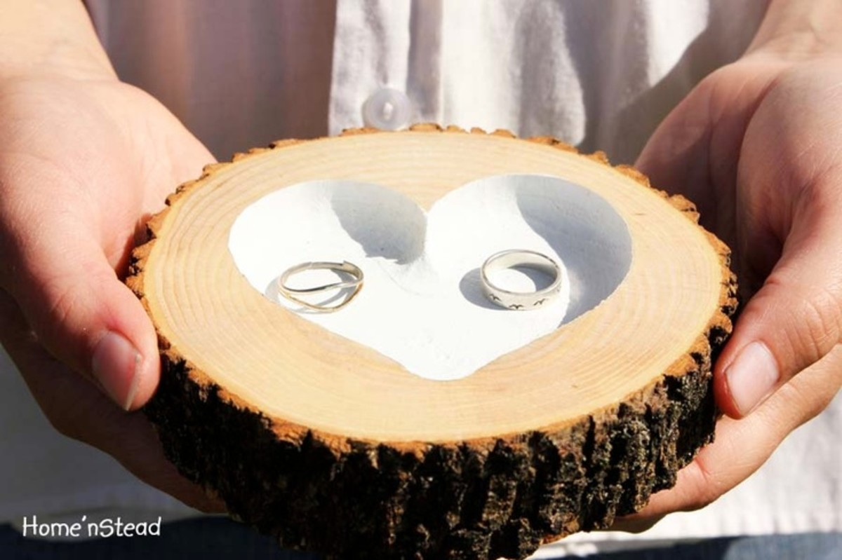 Natural wood with engraved heart to hold the wedding rings.