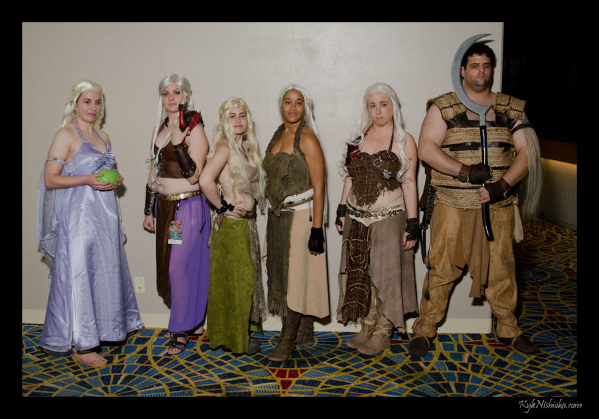 A collection of different Daenerys cosplayers with a Dothraki warrior.
