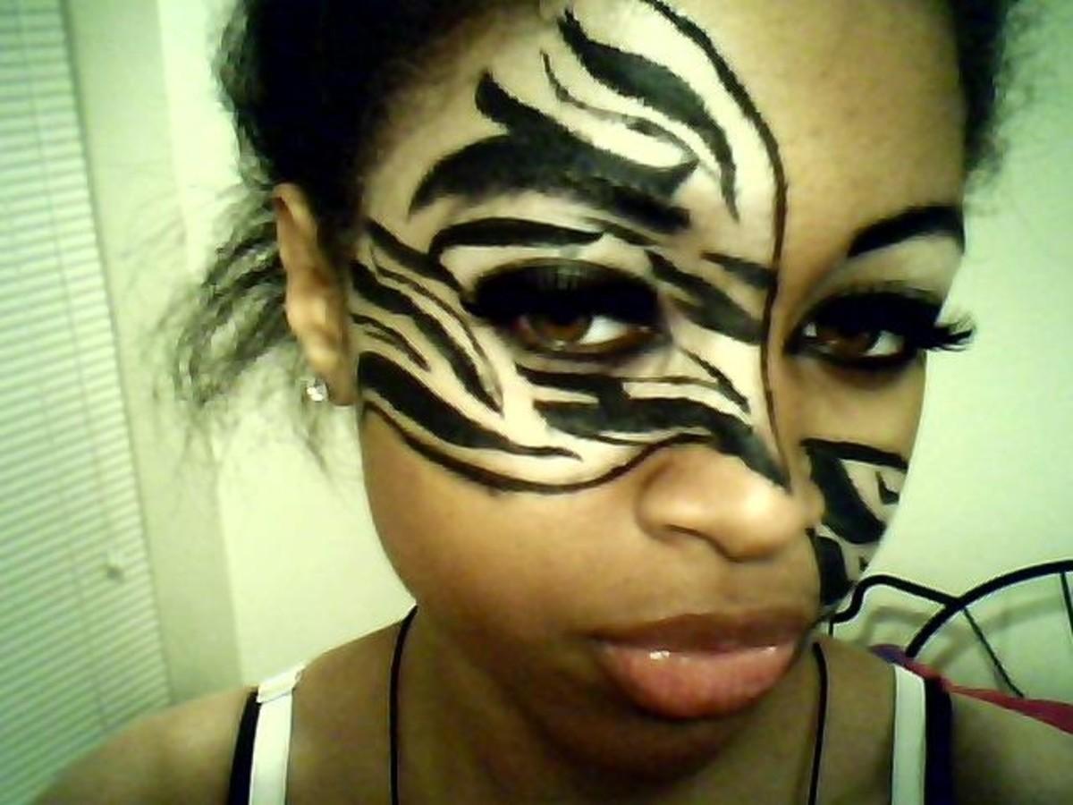 Zebra Makeup on Both Sides of Zebra Face Paint For Halloween