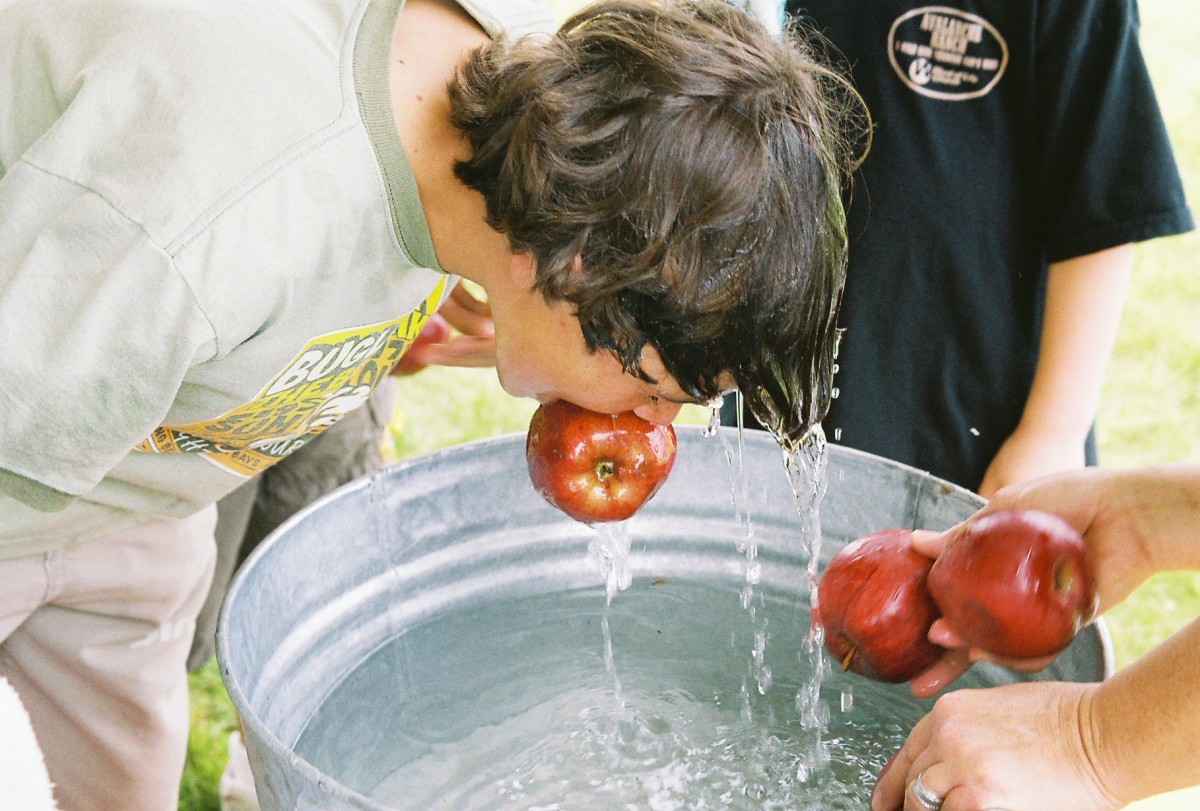 Bobbing for apples, often has the germ factor as well as the wet hair factor. There are some great alternatives!