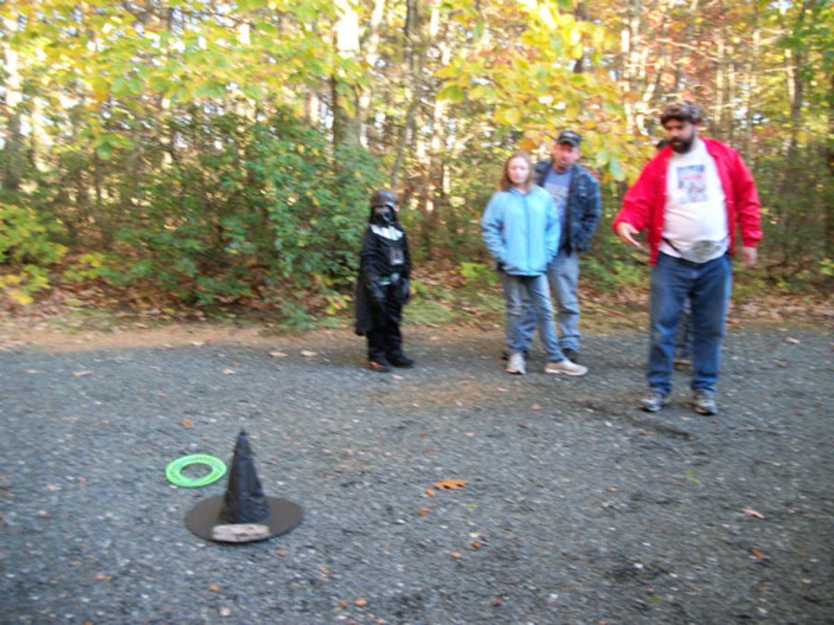 Brian didn't get any points on this try. You can see that we had to put a rock on the hat to keep it from blowing away. Note the line in the gravel to mark where to stand behind.