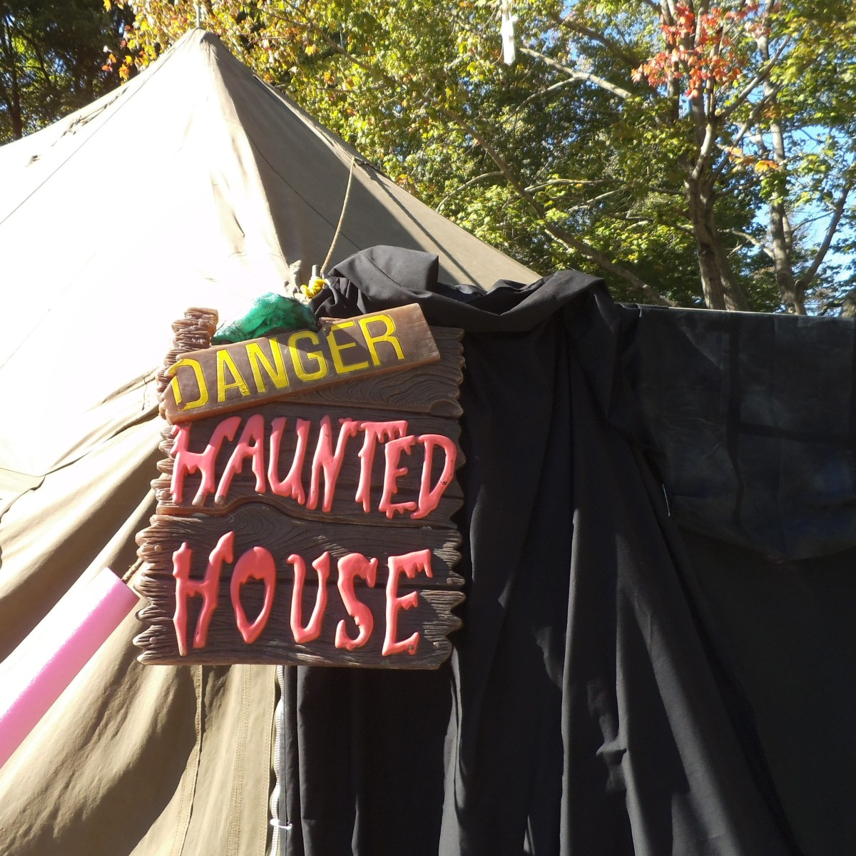 Here they've draped black sheets and painter's drop cloths to enclose part of the porch. The sign is one you could make with paint and boards you have around. I sure would be hesitant to enter.