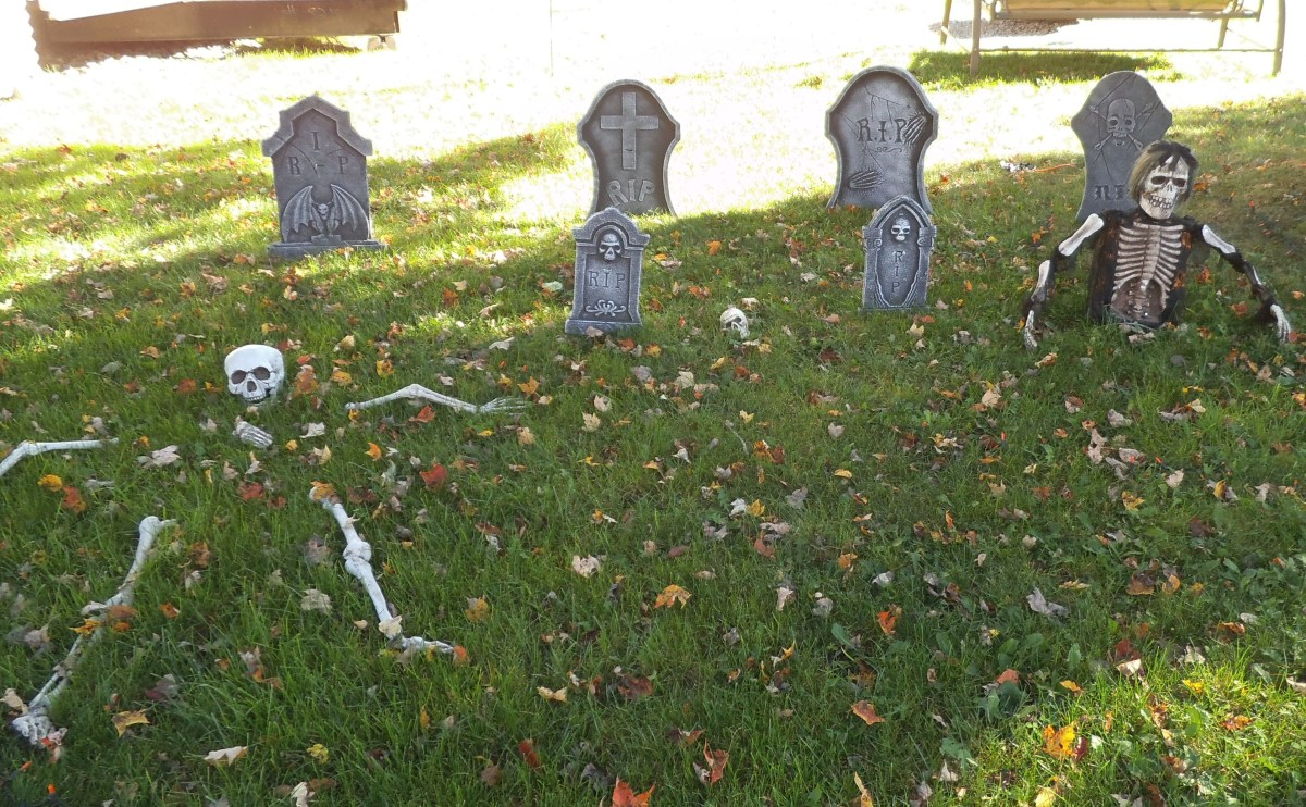 As visitors approach your spooky porch, set the atmosphere with some yard decor. A graveyard is a natural for this. I took the photo on a sunny day, but in the evening, this takes on a creepy look.