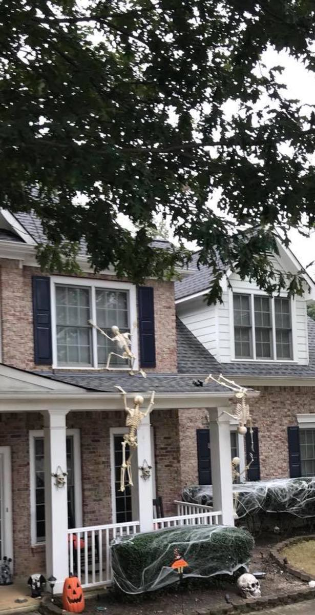 The house is being attacked by skeleton figures, which is very creative. All the bushes are shrouded in spider webs.