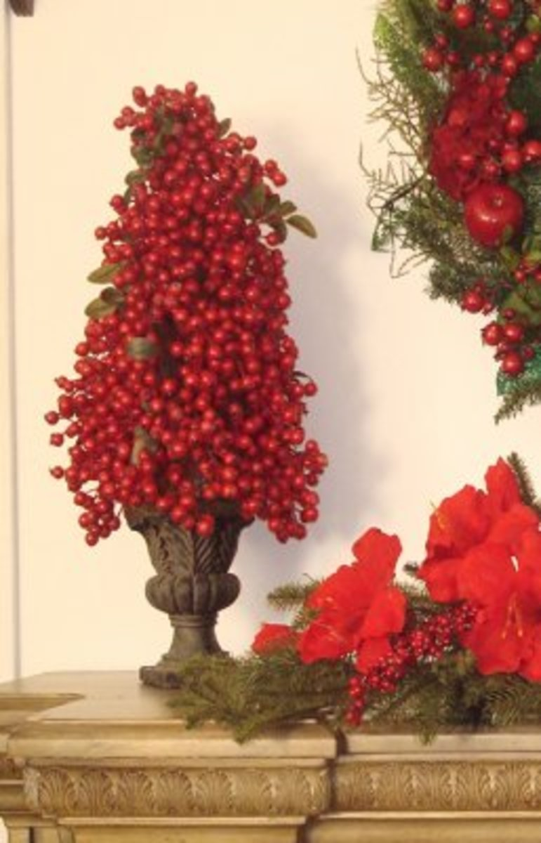 a red berry christmas topiary adds color and elegance to your decor - Christmas Topiary