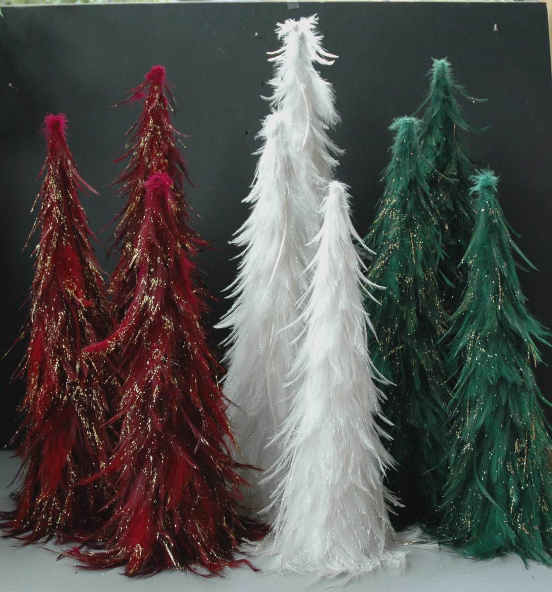 To make thinner or shorter trees like in this little forest, carve away portions of the floral cone before decorating.