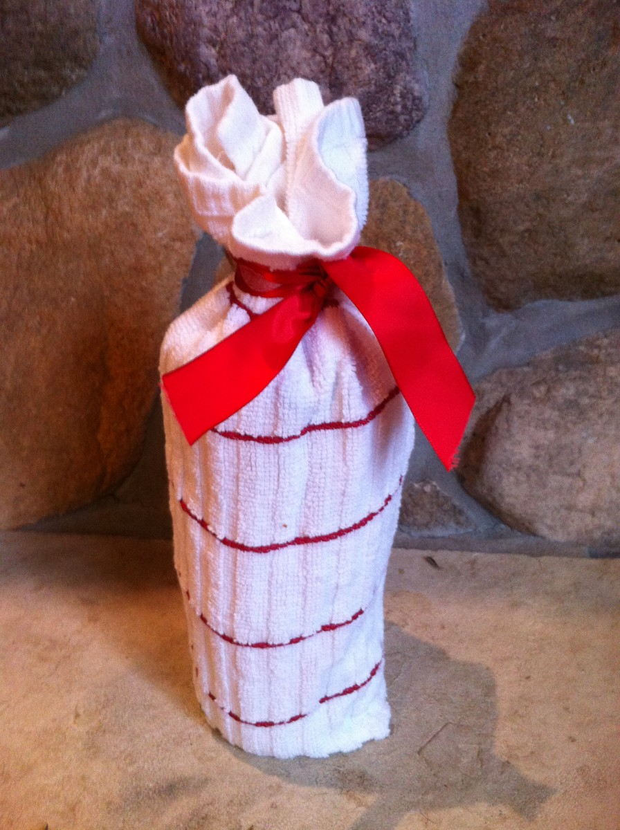 Wrap your gift in something that the recipient can use, like a hand towel or dish towel.