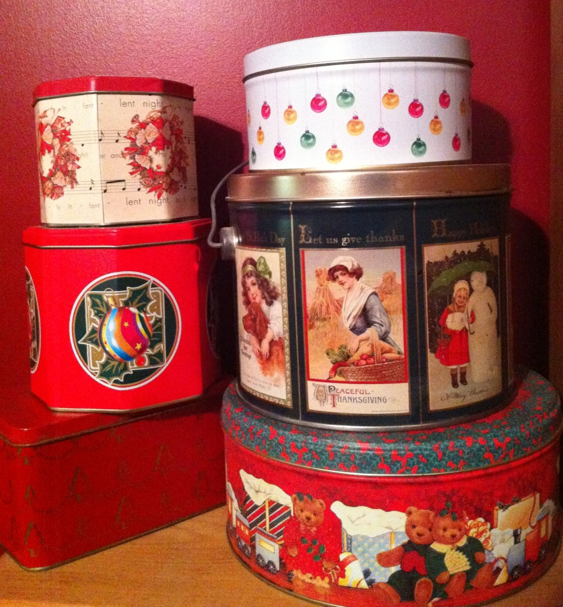 Decorative tins can be reused to wrap gifts year after year.