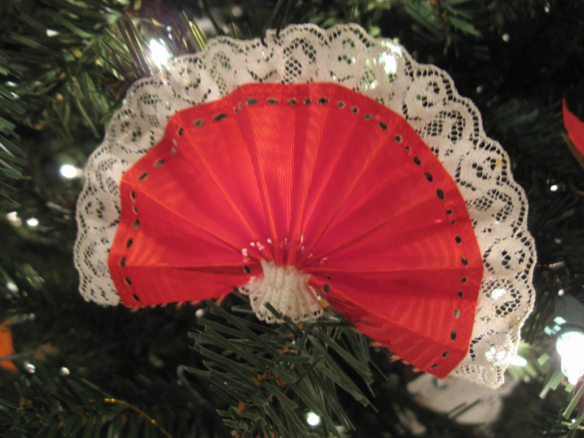 You can make these ornaments by pleating ribbon and stitching it at the bottom for a fan shape. Make some with blue ribbon, red ribbon, and ribbon with stars on them.
