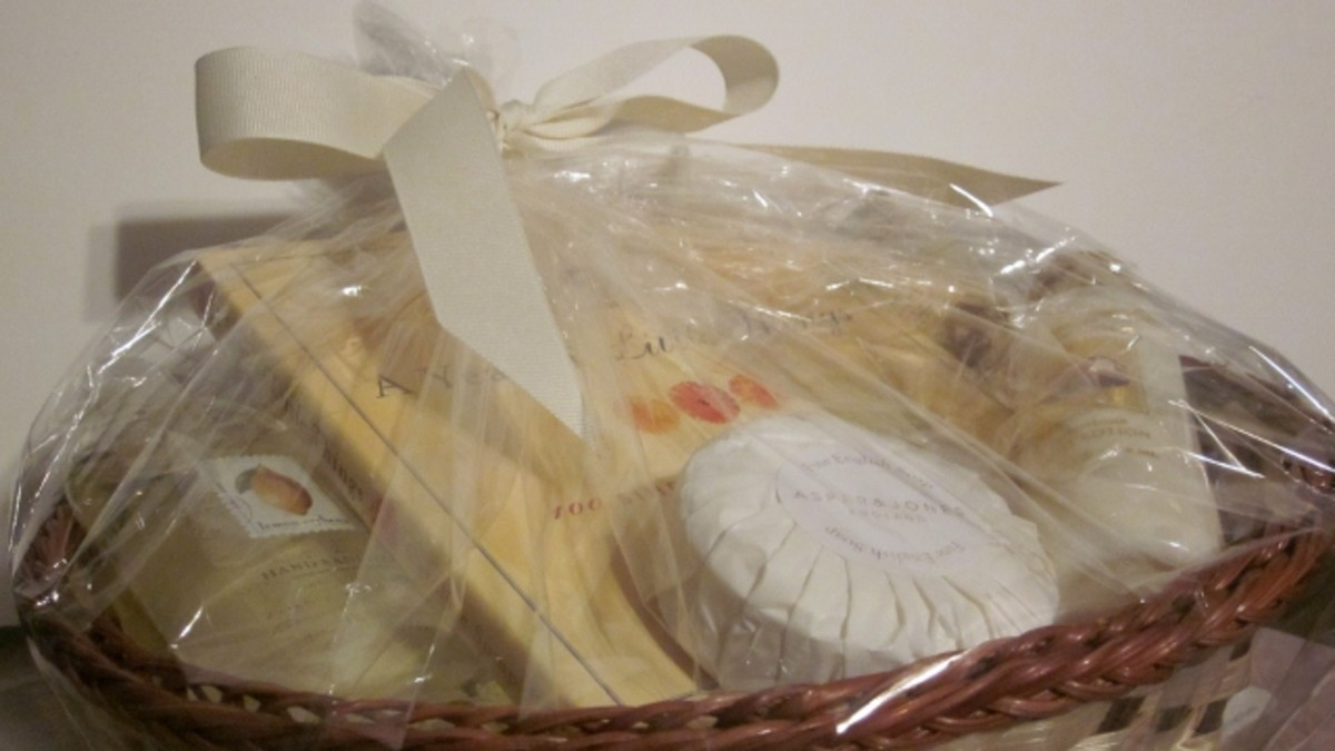This basket contains cream and yellow colored items which include: vanilla and citrus-scented products and an inpsirational book.